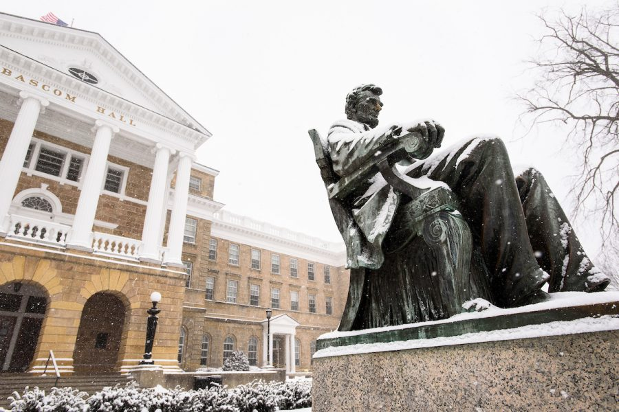 Lincoln statue in front of Bascom Hall covered in snow.