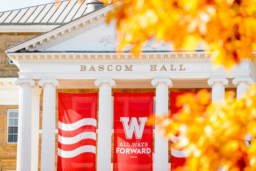 Picture of W campaign banner on Bascom Hall framed by golden leaves